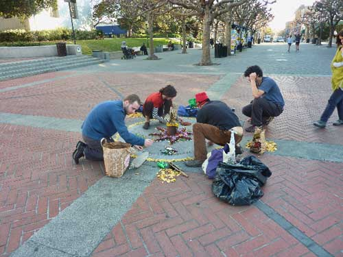 Four people appeared today (January 9) and painstakingly crafted a new mandela on the Free Speech Monument on Sproul Plaza.