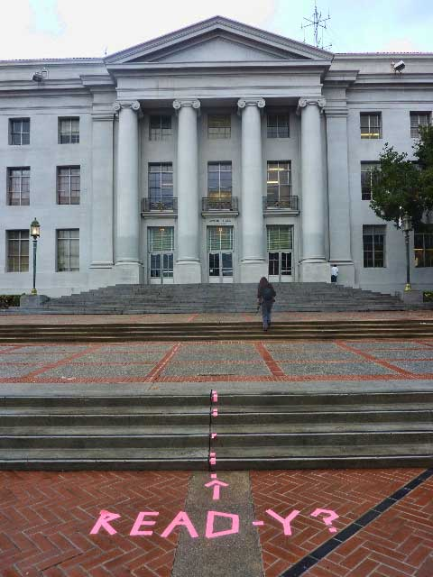 On December 15—four days after the Steps were cleared—this cryptic message in pink tape had been added to Sproul Plaza.  It was later removed.