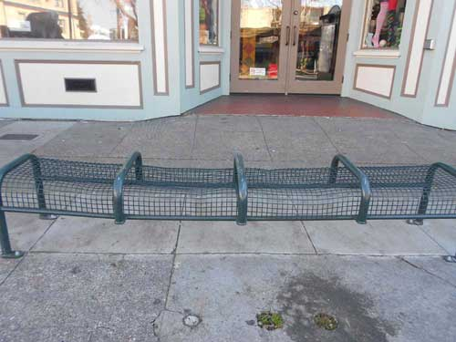 The bench at the bus stop in front of Peet's on Telegraph
