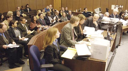 Attorneys for environmentalists, neighbors and the city (center foreground) prepare to argue with UC Berkeley, about the contested grove of oaks and the fate of the university's major buildings projects at and near Memorial Stadium. Photograph by Richard Brenneman.
