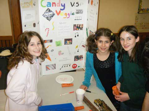 A team of fifth graders show off their experiment making musical instruments out of carrots.
