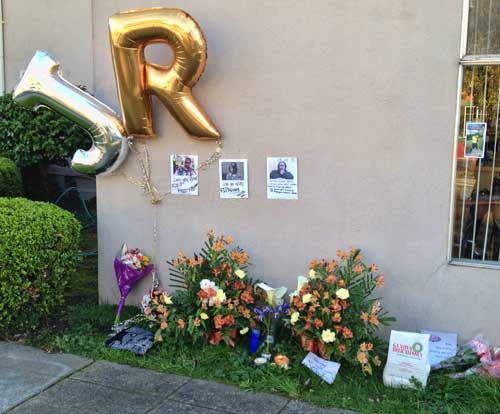"The J. R. on this memorial display on the wall of Don's Headquarters barber shop stands for ""Junior"", the name old friends and family called Berkeley murder victim Kenneth Warren."