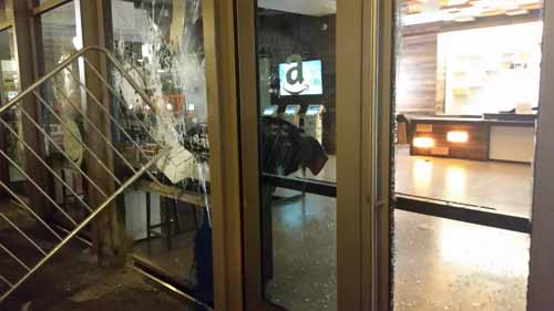Apparent protesters smash windows