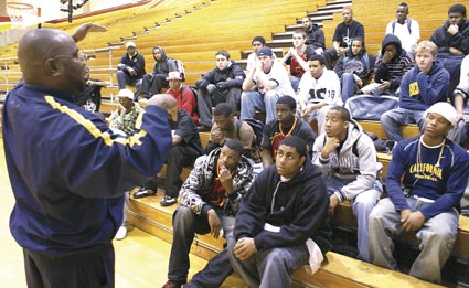 New Berkeley High football coach Alonzo Carter talks to his team for the first time Wednesday. Photograph by Mark Coplan.