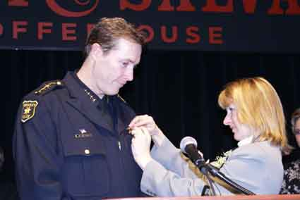 Michael Meehan, with a little help from his wife, Becky, was sworn in as Berkeley's new police chief today at Freight and Salvage Coffeehouse. More than 200 people attended the event, including police chiefs from all over the Bay Area, law enforcement officials, Berkeley city councilmembers and Mayor Tom Bates.