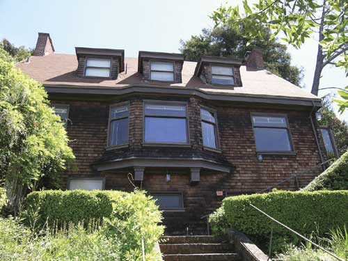The Torrey house façade features an oversized bay window.