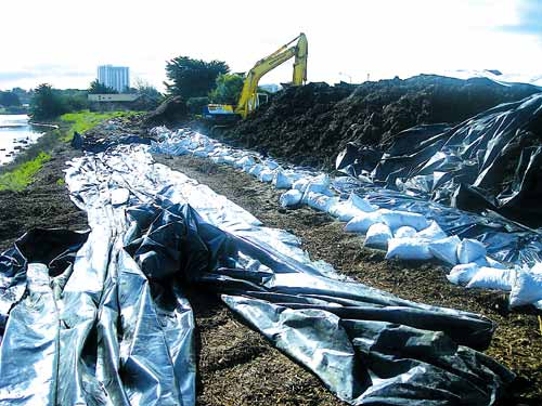 WR Forde constructed a watertight containment with plastic sheets and sandbags to prevent the contaminated dredging spoils from mixing with the Aquatic Park lagoon Wednesday, three months after the state water board ordered them to do so.
