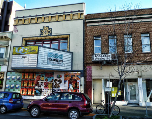 Long shuttered, the historic UC Theatre is scheduled for renovation into a live music venue.  The Landmarks Commission approved small modifications to the lobby, presently hidden behind a plywood barrier, and the adjacent commercial space on the right.
