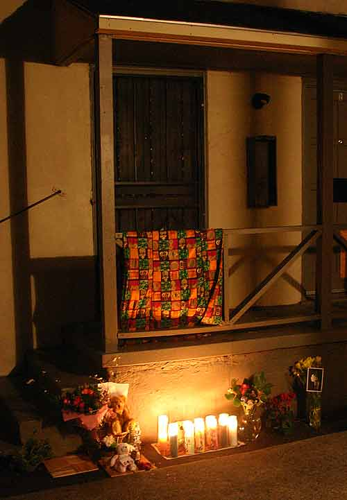 A shrine has been set up on the Ward Street porch where Anita Gay was shot and killed by a Berkeley police officer.