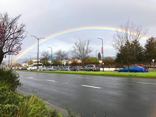 This rainbow was visible from the Tuesday Farmers' Market on Adeline Street.  Proposed high-rise development in this area might block views like this.