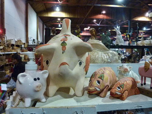 Items from women's hats, to wall art, stuffed animals, ceramic pigs, unusual fish, and furniture await in the White Elephant Sale warehouse on the Oakland Estuary.