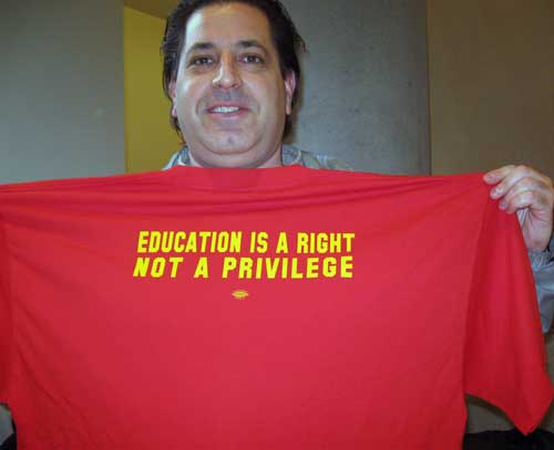 "Faculty and students are expected to wear this red T-shirt for the Thursday rally which says ""education is a right not a privilege."""