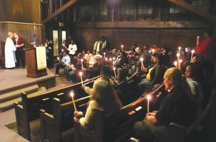 Mourners lit candles at the end of Thursday night's memorial service for Anita Gay, who was fatally shot outside her South Berkeley apartment by a police officer Feb. 16.