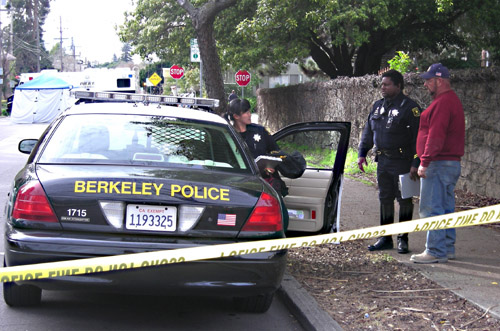 Berkeley police talk with the driver of a construction truck that struck and killed a LeConte Elementary School student at the intersection of Derby and  