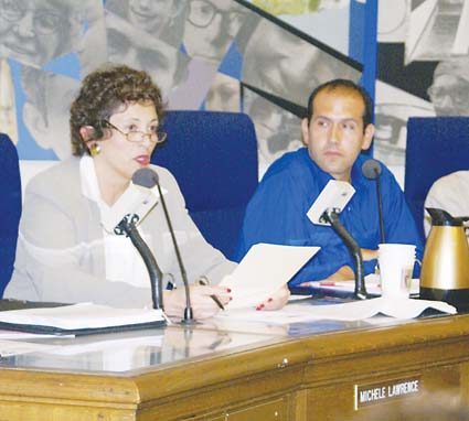 Former school board member Joaquin Rivera looks on as former Berkeley Unified Superintendent Michele Lawrence announces her retirement in Sept. 2007.