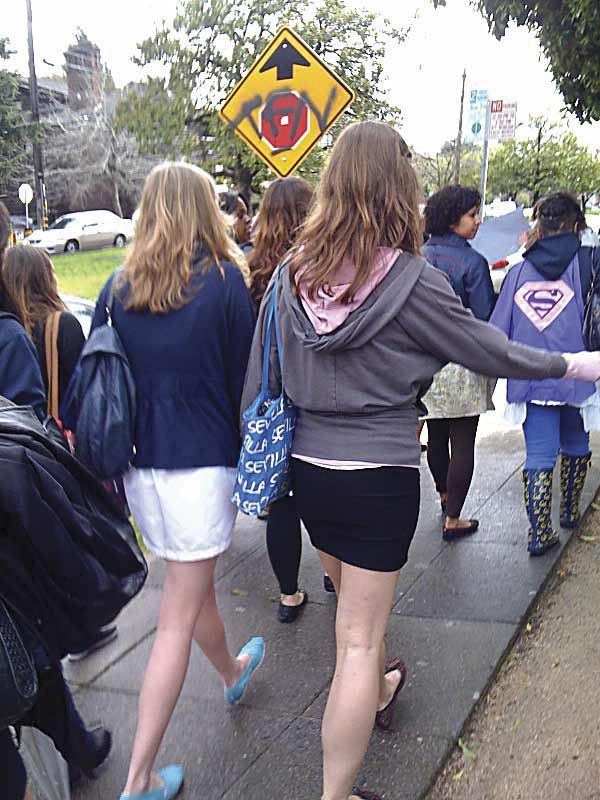 "Morgan (left), a college student who was assaulted by the sexual predator targeting young girls wearing skirts, walks down Piedmont Avenue with her friends during a Wednesday afternoon""skirt rally"" organized by UC Berkeley students."