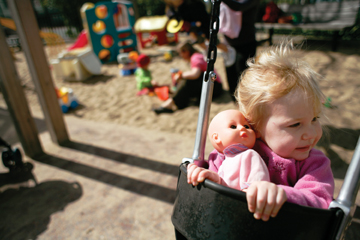 Stephan Babuljak: Sarah Hansen, 2, sits in a swing at Willard Park last week. Her mother said she had seen many rats at the park in the evening and no longer takes Sarah there after dusk..