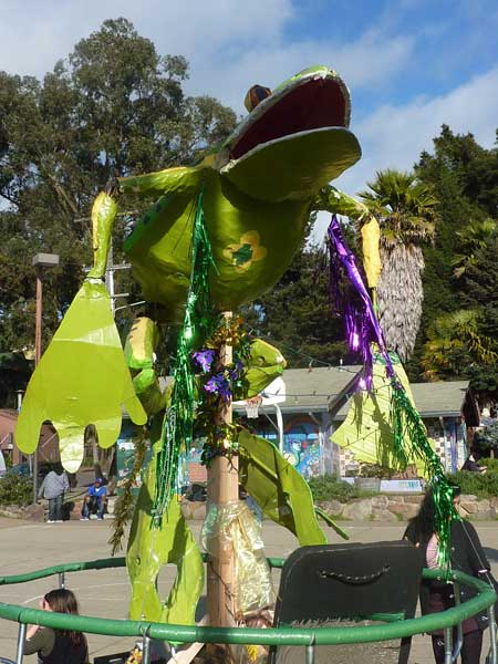 A giant rolling frog loomed above all at Berkeley's Mardi Gras Frog Parade.
