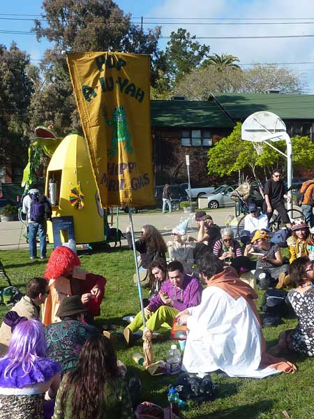 "Costumed participants gathered under the banner of the ""Hoppy Mardi Gras""
