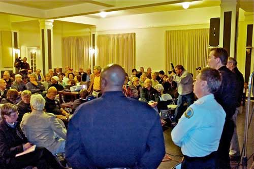 Chief Meehan, to right, 3rd, taking the heat Thursday night at community meeting on Hills murder. Officer White, left; Dispatch supervisor Lauborough, middle