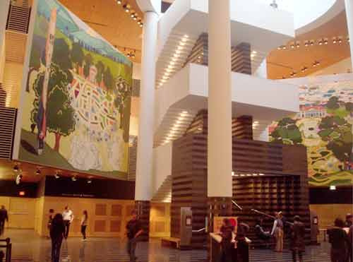The massive, columned, atrium of SF MOMA displays two Kerry James Marshall murals, Monticello at left, Mount Vernon at right.