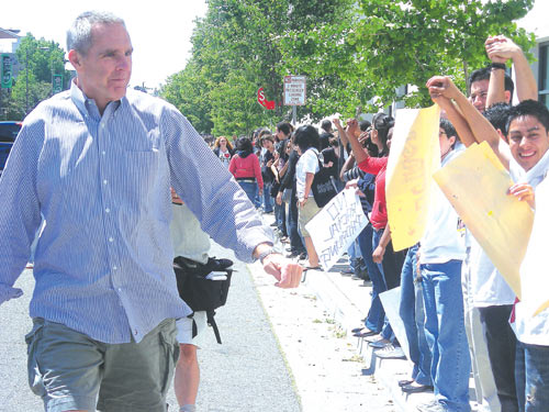 Berkeley High Principal Jim Slemp cheers on more than 3,000 high school students who formed a human chain around the campus in June 2008 to protest immigration raids by ICE agents in Berkeley.