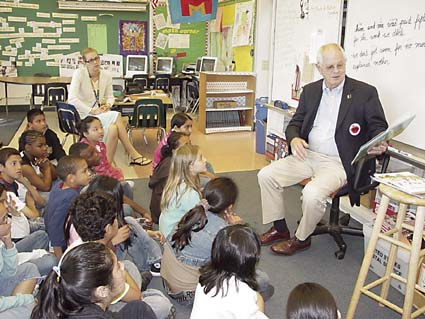 Mayor Tom Bates reads to fifth graders in Hilary Mitchell's class. Photograph by Mark Coplan.