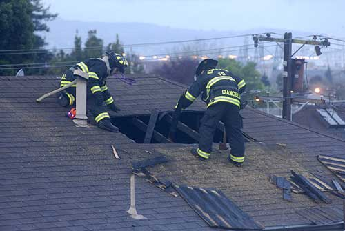 Berkeley firefighters chopped a hole in the roof of the burning house.