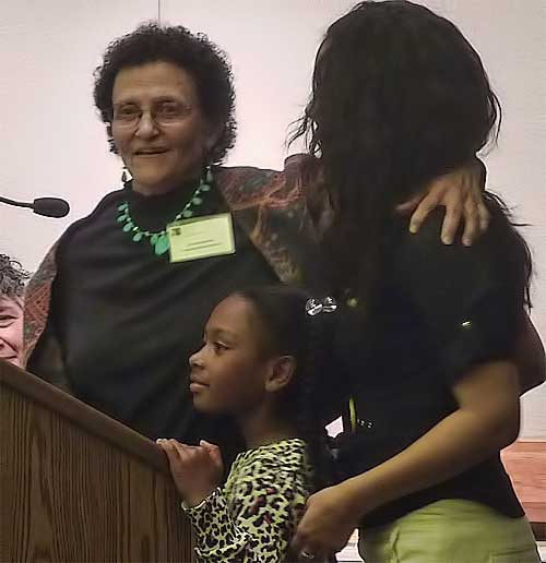 Dr. Vicki Alexander had family members join her at the podium when accepting her award.