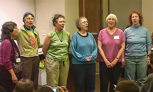Honoree Nancy Schimmel (right, in pink) sang with the Organic Women's Chorus as an interlude in the ceremony.