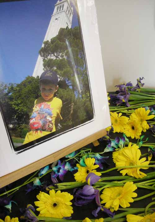 Flowers surround a photo of Zachary Michael Cruz in front of the UC Berkeley Campanile, one of the 5-year-old's favorite places.