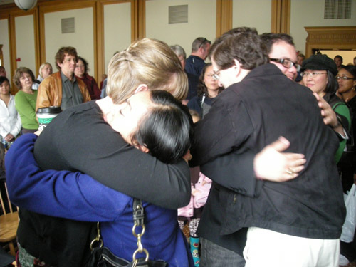 Frank and Jodie Cruz get hugs fromfriends after the service. Hundreds attended the memorial.