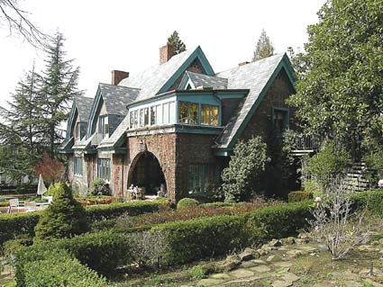 The south elevation of Allenoke Manor faces the gardens and Ridge Road.
