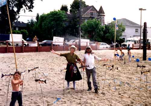 Carol Denney and Bob Nichols planted cardboard salmon in the sand volleyball court in 1991 to illustrate the path of the underground creek.