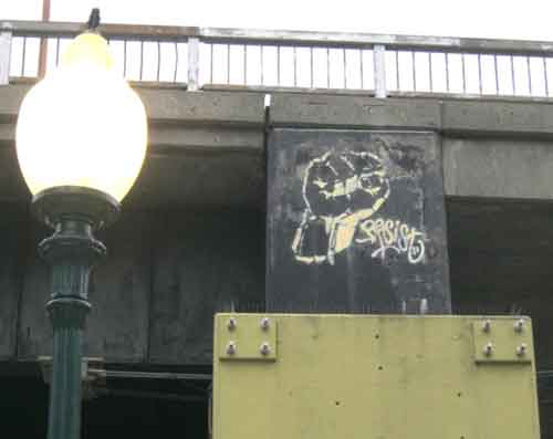 "The next time you're waiting for an AMTRAK train, cast your eyes upwards to the University Avenue overpass to the north. You might spot a piece of defiant art known as the ""Resist Fist."""