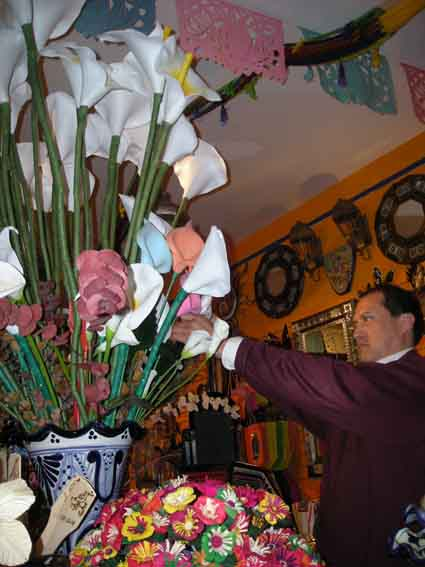 Antonio Robles arranges hand-crafted lilies from Guanajuato at Casa Oaxaca, which sells arts, crafts and jewelry from Mexico.