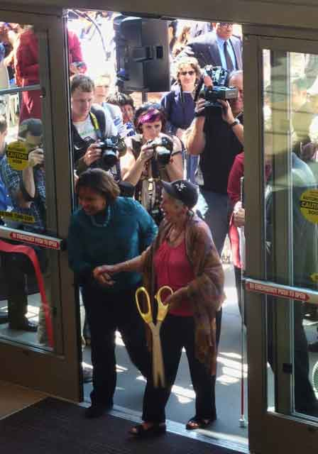 Lee and Roberts cut the red ribbon with gold shears and entered the building first.