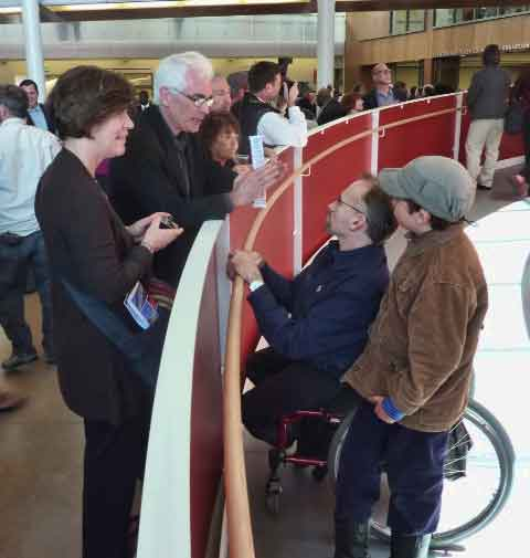 Project architect Bill Leddy (standing, left) and his colleague, Marsha Maytum, chat with local architect Erick Mikiten at the base of the ramp.