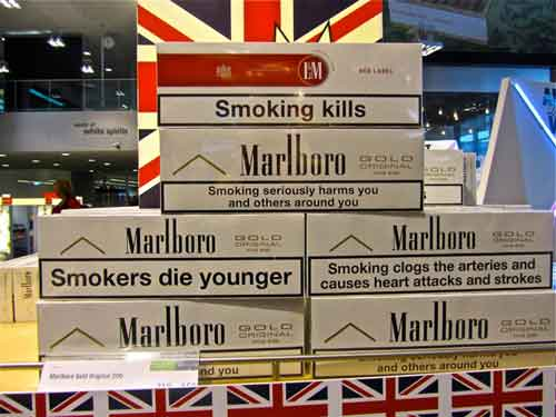 "Cigarettes for sale at the duty free shop at the Stockholm/Arlanda Airport.  Compare the tepid ""Surgeon General Warnings"" to the warnings required in Sweden."