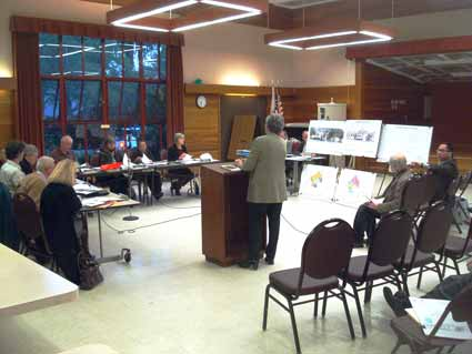 Kathleen Malstrom from Architectural Resources Group presented the design revisions to the Landmarks Preservation Commission.  Architect Doug Tom seated on far right.