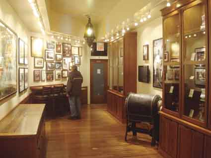 A lone customer examines the extensive Peet's memorabilia displayed in the expanded facility.