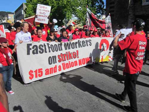 Minimum wage protesters marching down Bancroft toward Shattuck in Berkeley