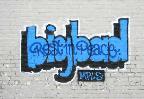 BigBad's tribute was short-lived. It lasted barely two weeks before the building owners grabbed a bucket of paint and dabbed BigBad's parting salute into oblivion.