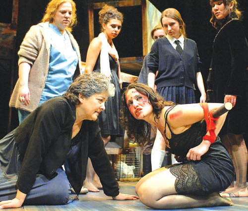 Hecuba (left, Carla Spindt) and Helen (right, Nora el Samahy) face off in front of the chorus in The Trojan Women.