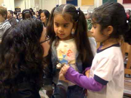 Angelica Perez talks with Franklin State Preschool and Parent Nursery students Isabella Perez and Amalia Flores at Wednesday night's Berkeley Board of Education meeting, just before they joined with many other students and parents in thanking the school board for preserving the school's half-day Spanish bilingual program.
