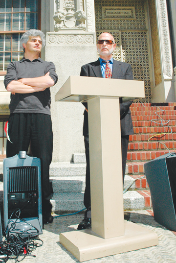 Richard Brenneman: UC Berkeley Assistant Professor Ignacio Chapela, left, and his attorney Dan Siegel held a press conference on the steps of Hilgard Hall to announce the filing of a lawsuit by Chapela challenging the university's denial of tenure to the outspoken critic of genetically modified crops and UC's ever-tighter embrace of corporate funding..