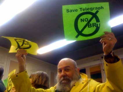 "Berkeley resident Alver H. Starkey holds up a ""No BRT"" sign with dozens of others at the City Council meeting Tuesday. ""I am here to stop BRT,"" Starkey said. ""We need cameras at bus stops, more care for A.C. Transit bus drivers as well as more trees."""