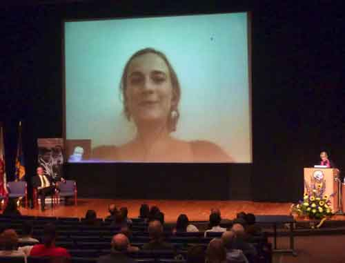 A Cal volunteer overseas talked live to a gathering in Wheeler Auditorium celebrating the 50th anniversary of the Peace Corps.  More Cal alumni have gone into the Peace Corps than from any other university in the United States.