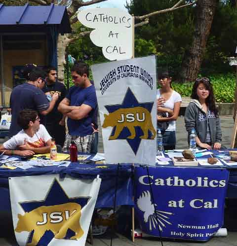 The Jewish Student Union and Catholics at Cal tabled side by side in the long arrays of student activity groups.