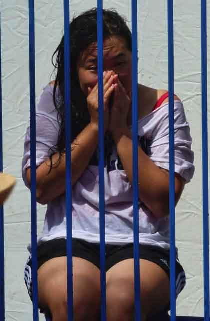 A student awaits immersion in a fundraising dunk tank on Lower Sproul.